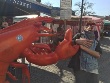 Philip getting attacked by a giant lobster at the fish market