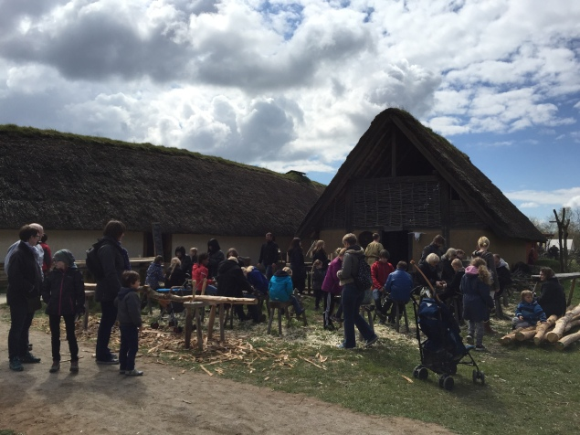 Crowds at the wood-carving station